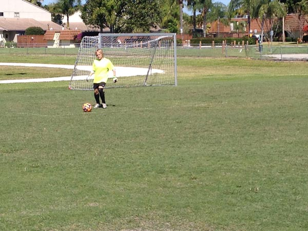 Goalie prepares to make a goal kick